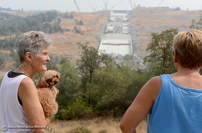 Coleen Willesen and her dog Felix, left and Fran Obrigewitsch of Oroville get their first look at the Oroville Dam Spillway since the emergency that closed Oro Dam Blvd. East to the public more than a year ago Monday, July 30, 2018. (Bill Husa -- Enterprise-Record)