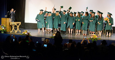 Graduates celebrate as their graduating class is announced during the Oroville Adult Education Center Class of 2018 graduation ceremonies at the State Theater in Oroville, Calif. Tuesday June 5, 2018. (Bill Husa -- Enterprise-Record)