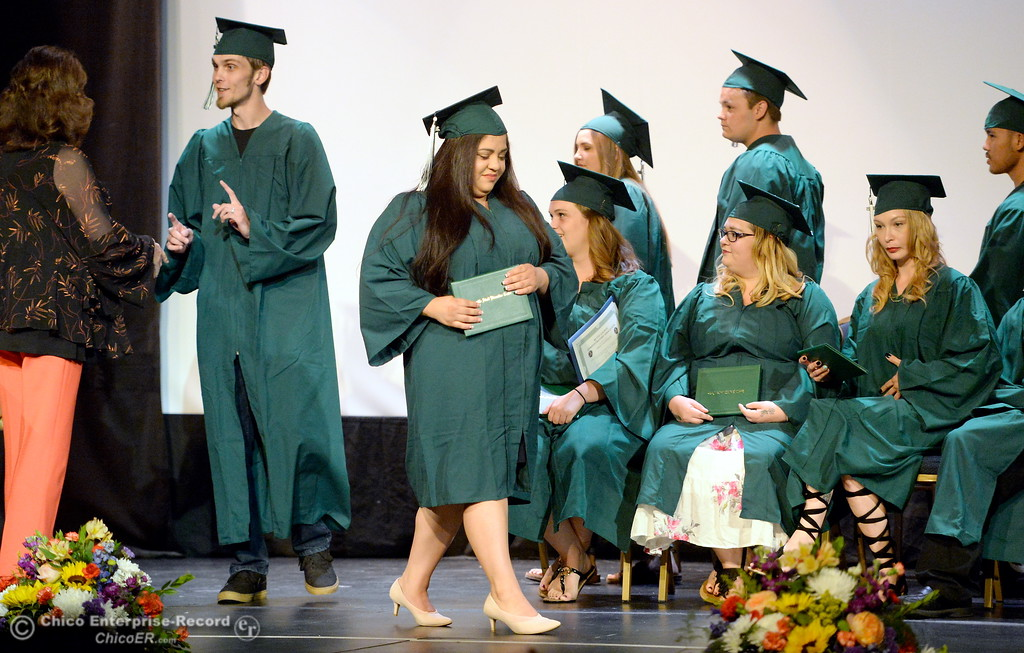 . Graduates receive their diplomas during the Oroville Adult Education Center Class of 2018 graduation ceremonies at the State Theater in Oroville, Calif. Tuesday June 5, 2018. (Bill Husa -- Enterprise-Record)