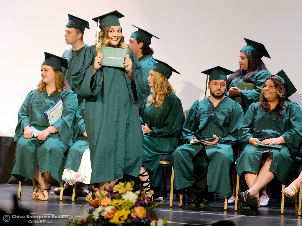 . Doris Marie Erkiliny smiles as she walks across the stage with her diploma during the Oroville Adult Education Center Class of 2018 graduation ceremonies at the State Theater in Oroville, Calif. Tuesday June 5, 2018. (Bill Husa -- Enterprise-Record)