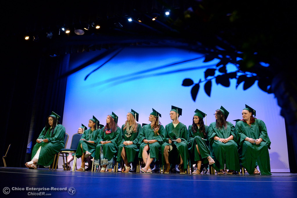 . Happy graduates smile and applaud one another during the Oroville Adult Education Center graduation ceremonies at the State Theatre in Oroville, Calif. Tues. June 6, 2017. (Bill Husa -- Enterprise-Record)