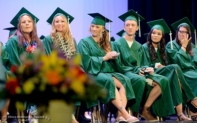 Happy graduates smile and applaud one another during the Oroville Adult Education Center graduation ceremonies at the State Theatre in Oroville, Calif. Tues. June 6, 2017. (Bill Husa -- Enterprise-Record)