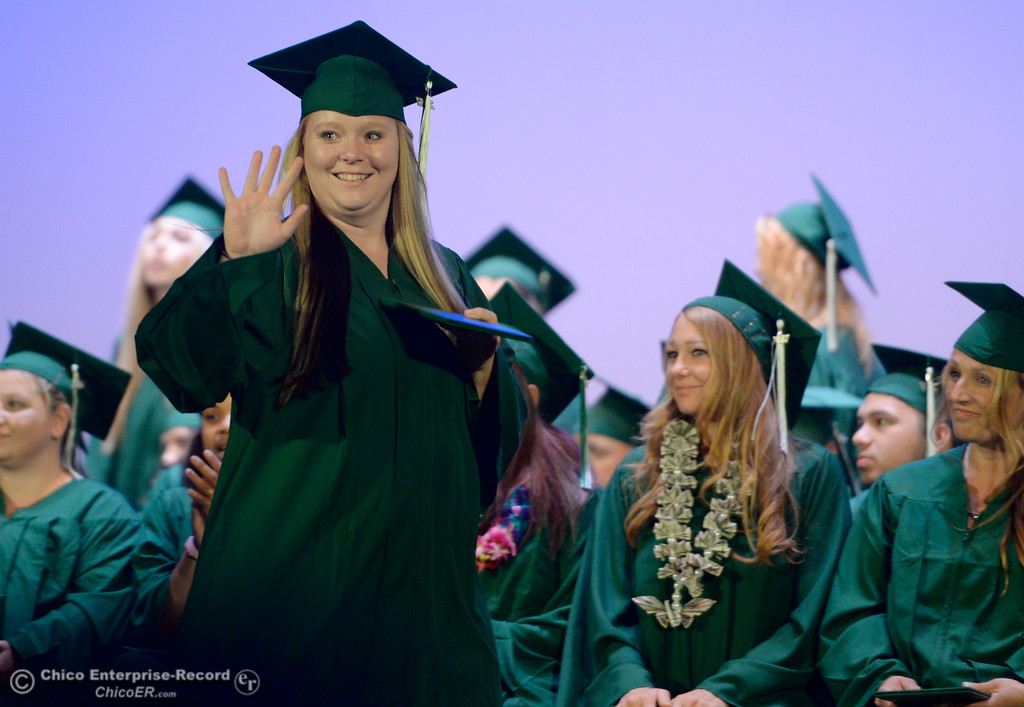 . Proud graduates smile after receiving their diplomas during the Oroville Adult Education Center graduation ceremonies at the State Theatre in Oroville, Calif. Tues. June 6, 2017. (Bill Husa -- Enterprise-Record)