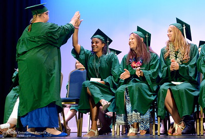 Pauline Trolinger gets a high five from Lori Johnson as she concludes her speach during the Oroville Adult Education Center graduation ceremonies at the State Theatre in Oroville, Calif. Tues. June 6, 2017. (Bill Husa -- Enterprise-Record)
