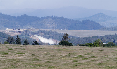 A view of the Orovoille Dam, Spillway and the vast mountain range it corral March 27, 2017 in Oroville, California. (Emily Bertolino -- Enterprise-Record)