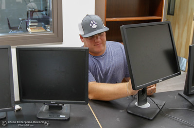 Engineering, architecture and graphic design teacher Kyle Dahldren gets his computers ready for the start of the fall semester August 15, 2016 at Oroville High School in Oroville, Calif. (Emily Bertolino -- Mercury Register)