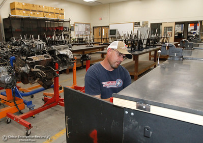 Automotive technology teacher Daniel Briggs organizes the individual work stations as he prepares his classroom for the start of the fall semester August 15, 2016 at Oroville High School in Oroville, Calif. (Emily Bertolino -- Mercury Register)