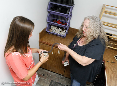 Co-teachers in the visual arts department at Oroville High School Ms. Lehardy and Mrs. Molchen practice rolling up a reel of film into a developing reel (with the lights on) in preparation of the fall semester August 15, 2016 at Oroville High School in Oroville, Calif. (Emily Bertolino -- Mercury Register)