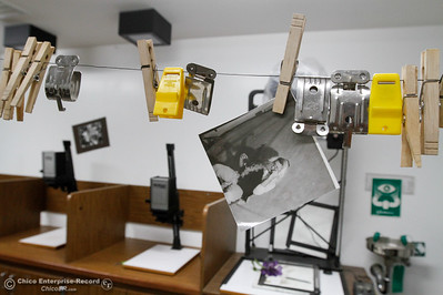 A developed photo hangs in the dark room at Oroville High School as teachers prepare for the start of the fall semester August 15, 2016 in Oroville, Calif. (Emily Bertolino -- Mercury Register)
