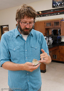 Jeff Reid a general biology and physical science teacher  explains how fossils are made as he prepares his classroom for back to school August 15, 2016 at Oroville High School in Oroville, Calif. (Emily Bertolino -- Mercury Register)