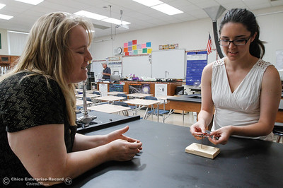 Physics, chemistry and biology teacher Leanna Felardo watches as co-teacher Emily Bladorn tries to balance 12 nails on one August 15, 2016 at Oroville High School in Oroville, Calif. The two are preparing 12 challenges for the incoming physics class that will teach then about balance on the first day of school. (Emily Bertolino -- Mercury Register)