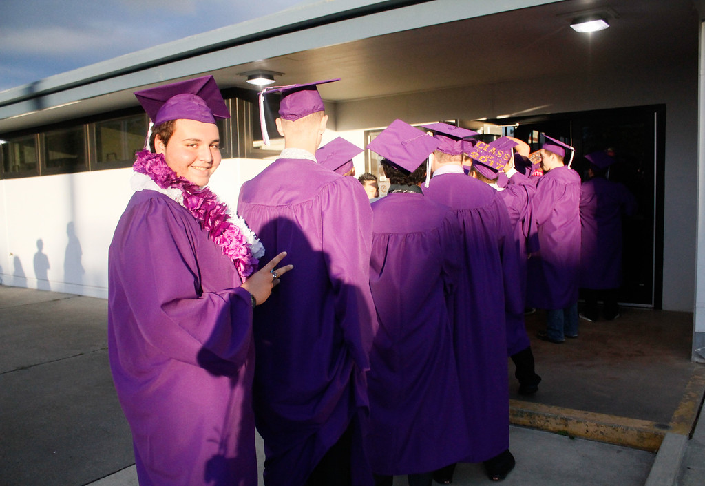 . The senior Tigers line up in preparation for the Oroville High School class of 2017 graduation ceremony Thursday June 8, 2017 at Harrison Stadium in Oroville, California. (Emily Bertolino -- Enterprise-Record)