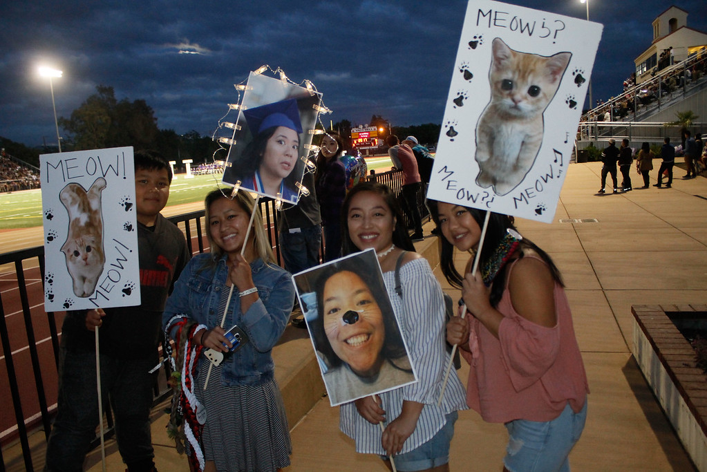 . Friends and family of Oroville High School graduate Cheyenne Chue, pictured, show their support during the graduation ceremony Thursday June 8, 2017 at Harrison Stadium in Oroville, California. (Emily Bertolino -- Enterprise-Record)