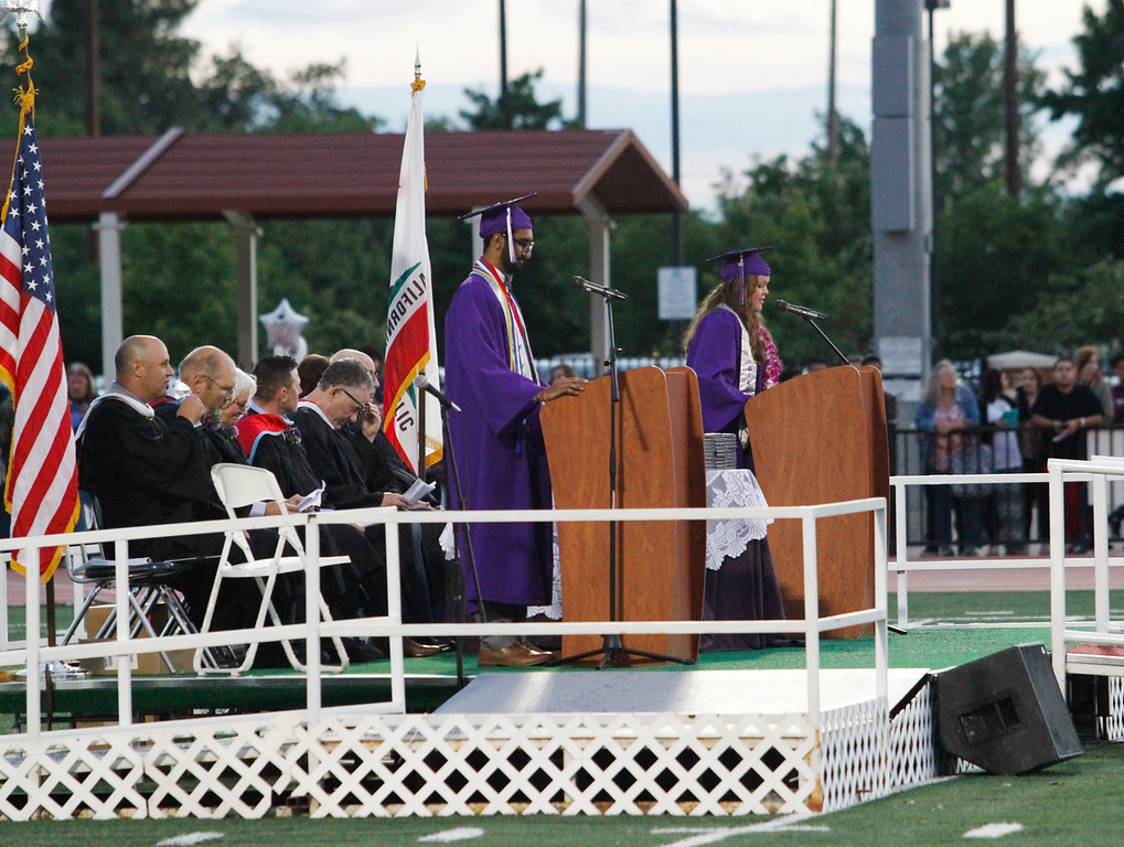 . Gurpratap Ghuman and Rebecca Horn start the graduation with a welcome during the Oroville High School class of 2017 commencement ceremony Thursday June 8, 2017 at Harrison Stadium in Oroville, California. (Emily Bertolino -- Enterprise-Record)