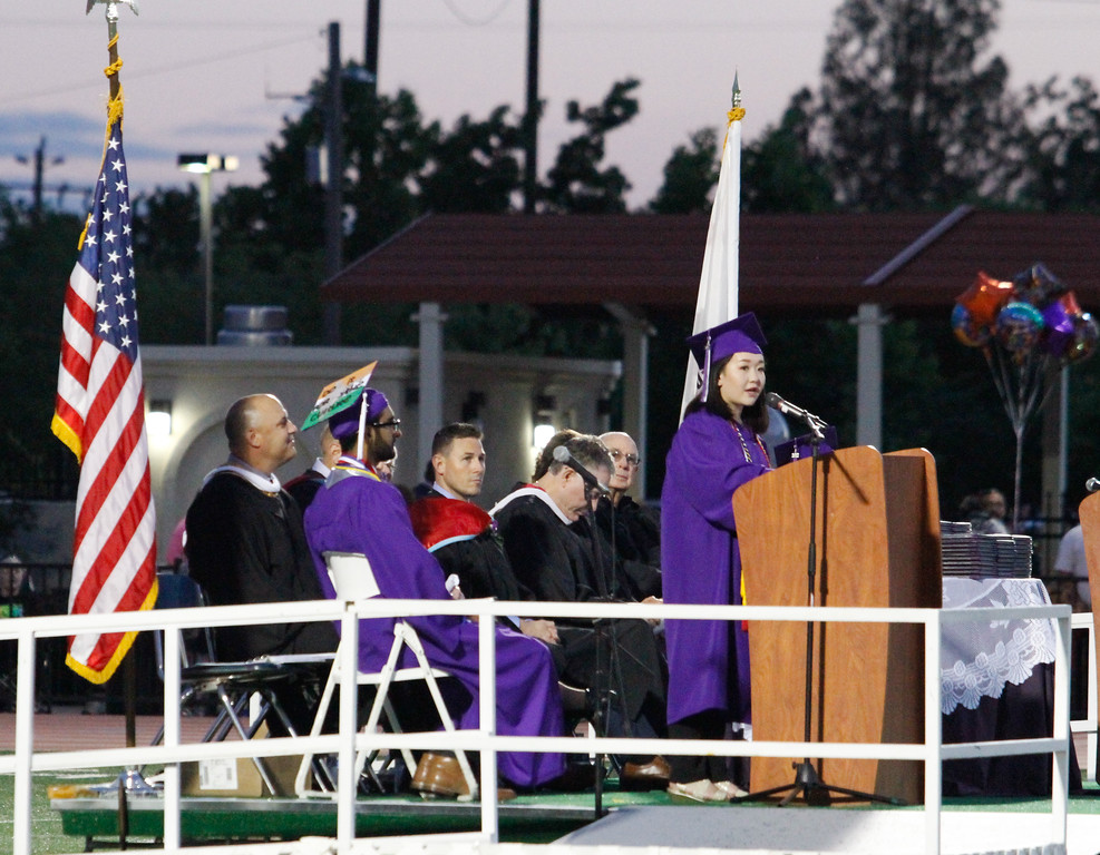 . Mai Her Thao, Orovile High School class of 2017 salutatorian gives a speech during the graduation ceremony Thursday June 8, 2017 at Harrison Stadium in Oroville, California. (Emily Bertolino -- Enterprise-Record)