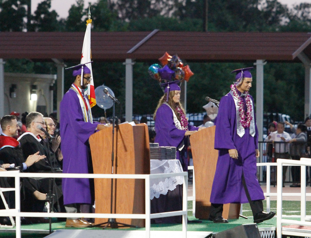 . Hunter Monnot, Orovile High School class of 2017 valedictorian exits the stage after his uplifting speech during the graduation ceremony Thursday June 8, 2017 at Harrison Stadium in Oroville, California. (Emily Bertolino -- Enterprise-Record)