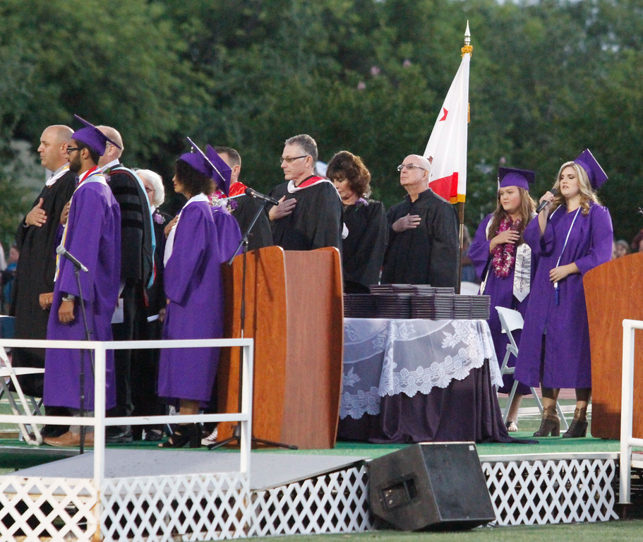 . Zoey Rash sings the National Anthem during the Oroville High School class of 2017 graduation ceremony Thursday June 8, 2017 at Harrison Stadium in Oroville, California. (Emily Bertolino -- Enterprise-Record)