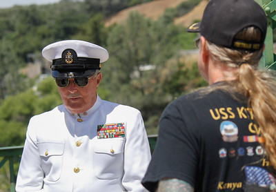Navy Veteran Stephen Adams talks about his experience serving in Dessert Storm and Vietnam as fellow Navy Veteran Jack Dennis listens during the annual Memorial Day ceremony Monday May 29, 2017 on the green bridge in downtown Oroville, California. (Emily Bertolino - Mercury Register)