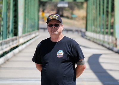 Veteran Jack Dennis served in the Navy during the Vietnam War at attends the annual Memorial Day ceremony Monday May 29, 2017 on the green bridge in downtown Oroville, California. (Emily Bertolino - Mercury Register)