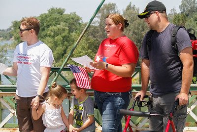 Scott Allen, Tiffany Robison (3), Robert Robison the third (5), Deliah Robison, and Robert Robision Jr. attend the annual Memorial Day ceremony Monday May 29, 2017 on the green bridge in downtown Oroville, California. (Emily Bertolino - Mercury Register)