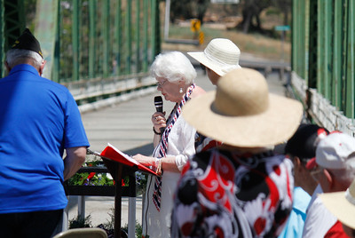 Sherry Morehouse leads the annual Memorial Day ceremony Monday May 29, 2017 on the green bridge in downtown Oroville, California. (Emily Bertolino - Mercury Register)