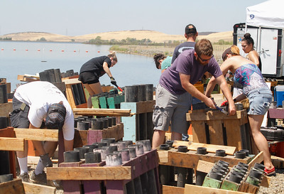 The crew with Pyro Spectaculars are busy setting up for the Fourth of July firework show July 3, 2017 at the Thermalito Forebay in Oroville, California.  (Emily Bertolino -- Mercury-Register)