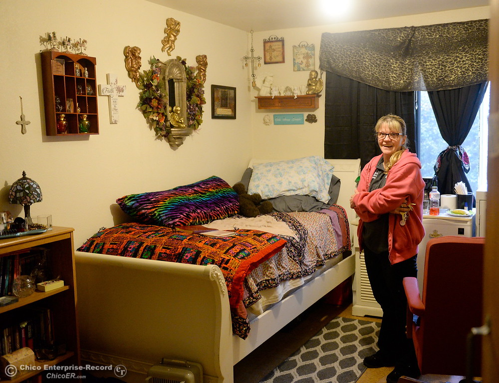 ". Kara Conn smiles as she talks about the womens services area during a tour of the Oroville Rescue Mission on Lincoln Blvd. in Oroville, Calif. Thurs. Nov. 9, 2017.  Conn said, ""I lived in a tent at the dog park, before I came here.\"" (Bill Husa -- Enterprise-Record)"