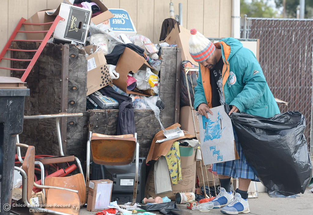 . Asofiafia Tuaau, AKA Junior works on a pile near the donation bin seen during a tour of the Oroville Rescue Mission on Lincoln Blvd. in Oroville, Calif. Thurs. Nov. 9, 2017.  (Bill Husa -- Enterprise-Record)