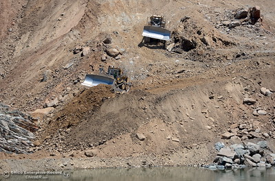 Dozers work on one side as construction continues on the Lake Oroville Dam Spillway Wednesday May 24, 2017.  (Bill Husa -- Enterprise-Record)