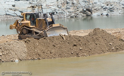 A dozer works on what appears to be a new road being constructed beneath the spillway as construction continues on the Lake Oroville Dam Spillway Wednesday May 24, 2017.  (Bill Husa -- Enterprise-Record)