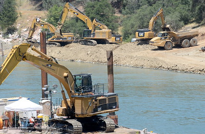 Excavators work close together downstream from the spillway in the Diversion Pool as construction continues on the Lake Oroville Dam Spillway Wednesday May 24, 2017.  (Bill Husa -- Enterprise-Record)