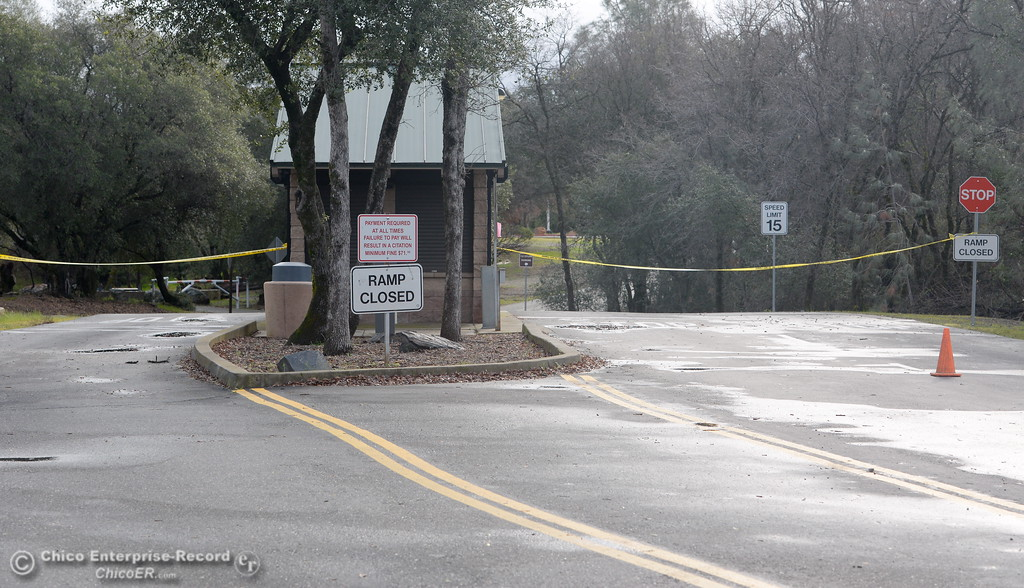 . Signs and yellow tape block the entrance to Lime Saddle Marina along Pentz Rd. in Paradise, Calif. Tues. Feb. 21, 2017. The boat ramps at Lime Saddle and Bidwell Canyon Marina remain closed Tuesday.  (Bill Husa -- Enterprise-Record)