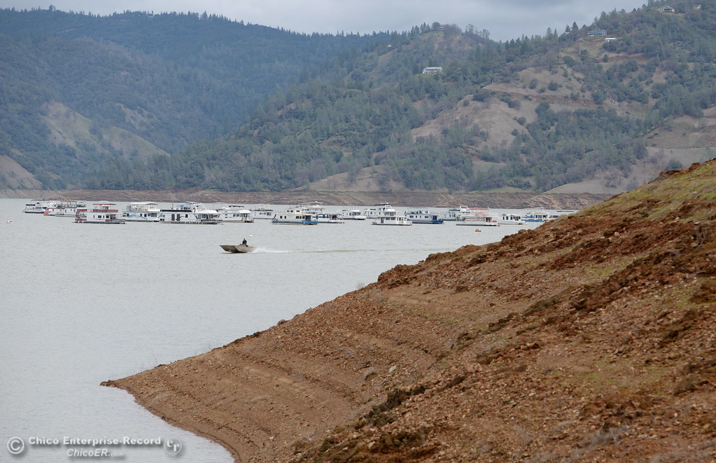 . A single boat is seen moving across the water while Lake Oroville boat launch facilities remain closed as work at the Oroville Dam, Oroville Spillway continues Tuesday Feb. 21, 2017. (Bill Husa -- Enterprise-Record)