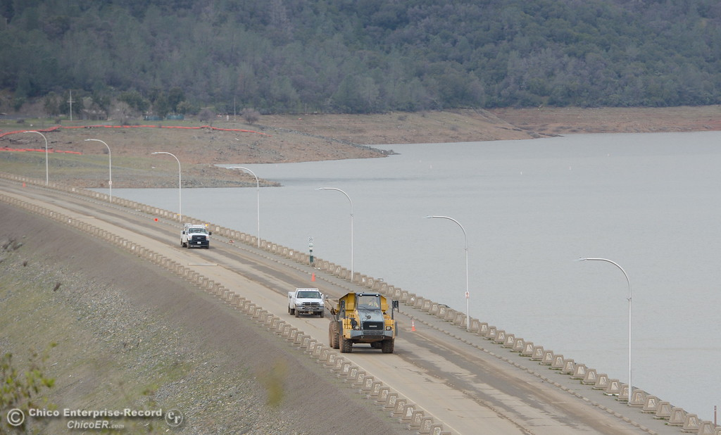 . Trucks cross the Oroville Dam as work at the Oroville Dam, Oroville Spillway continues Tuesday Feb. 21, 2017. (Bill Husa -- Enterprise-Record)