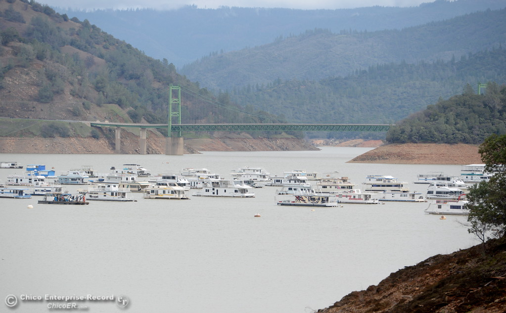 . Houseboats patiently wait for their owners near Bidwell Canyon Marina as work at the Oroville Dam, Oroville Spillway continues Tuesday Feb. 21, 2017. (Bill Husa -- Enterprise-Record)