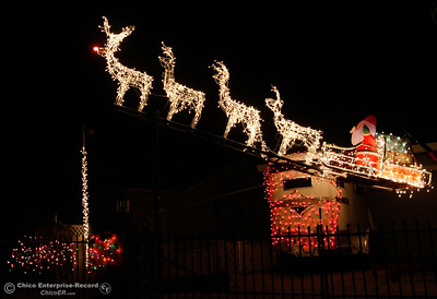 Santa's reindeer are taking flight in the front yard of this house adorned with Christmas lights on Hercules Avenue December 7, 2016 in Oroville, California. (Emily Bertolino -- Mercury Register)