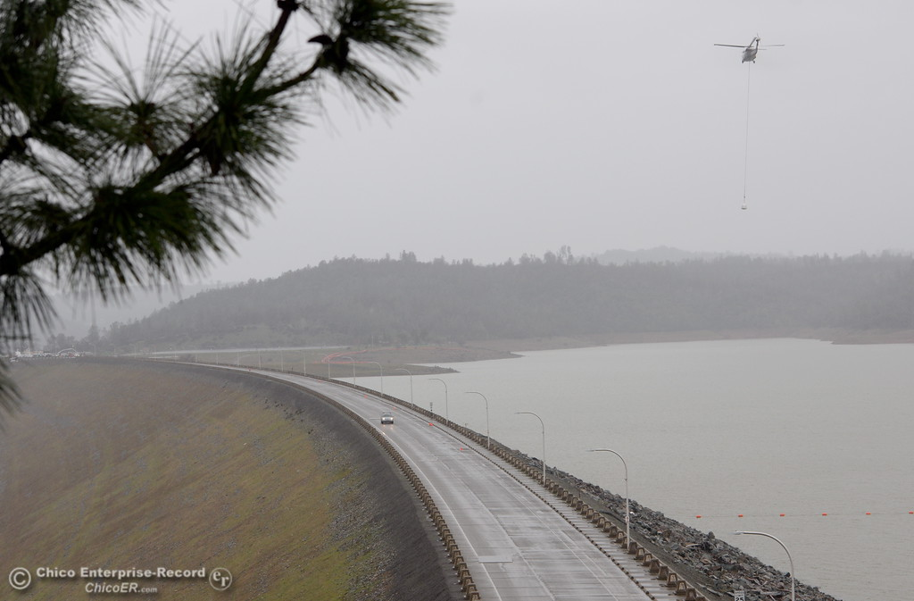 . Fewer trucks and helicopters are seen Friday as the Lake Oroville Dam Spillway emergency continues in Oroville, Calif. Frid. Feb. 17, 2017. (Bill Husa -- Enterprise-Record)