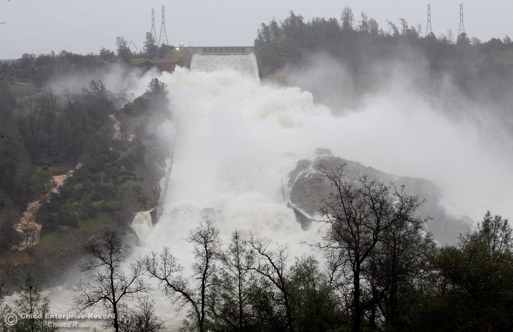 . The damaged spillway continues to do its job with water releases being decreased on the Lake Oroville Dam Spillway in Oroville, Calif. Friday, Feb. 17, 2017. (Bill Husa -- Enterprise-Record)