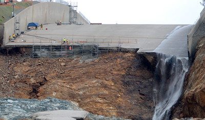 Scaffolding or metal work of some type is visible at the edge of the broken spillway as work continues to remove debris from below the Oroville Dam spillway Monday March 6, 2017.  (Bill Husa -- Enterprise-Record)