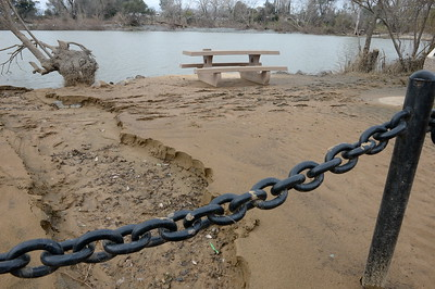 Although a thick layer of silt generally covers most of the area near the fishing pond and dog park at Riverbend Park the fences, tables, signs, fishing dock etc. seem to have faired a bit better than other parts of the park seen during a tour of the damaged areas within the park Monday March 6, 2017.  (Bill Husa -- Enterprise-Record)
