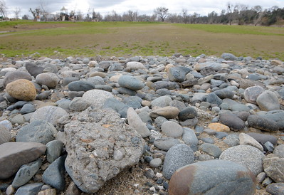 Rocks are piled up near one of the soccer fields seen at Riverbend Park during a tour of the damaged areas within the park Monday March 6, 2017.  (Bill Husa -- Enterprise-Record)