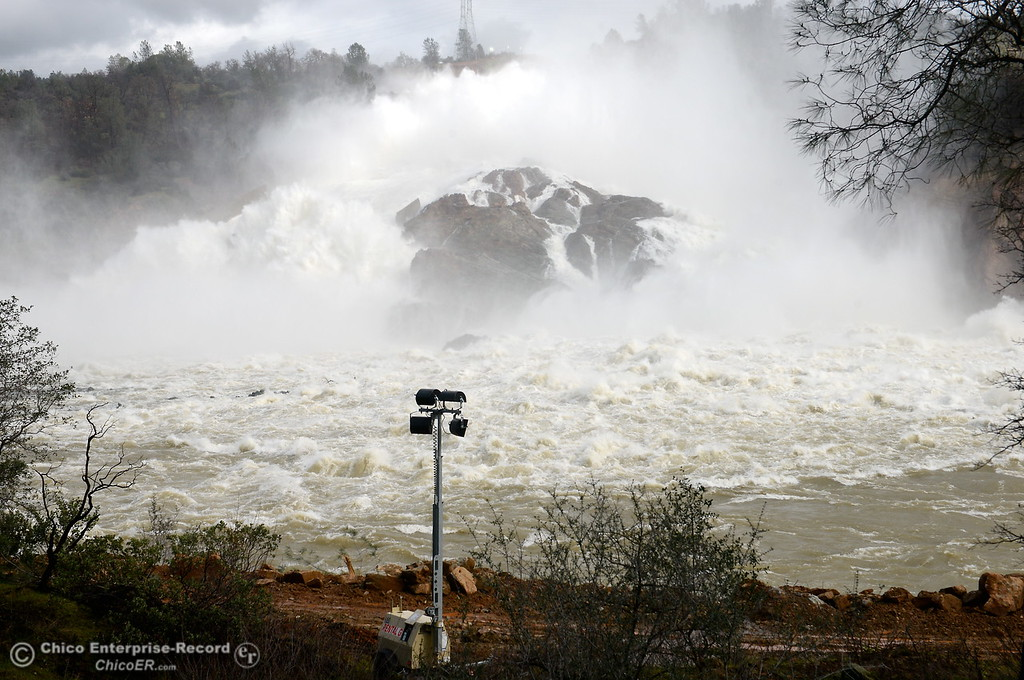 . It appears the water might be shallow behind a large rock as the Lake Oroville Dam Spillway emergency continues in Oroville, Calif. Thurs. Feb. 16, 2017. (Bill Husa -- Enterprise-Record)
