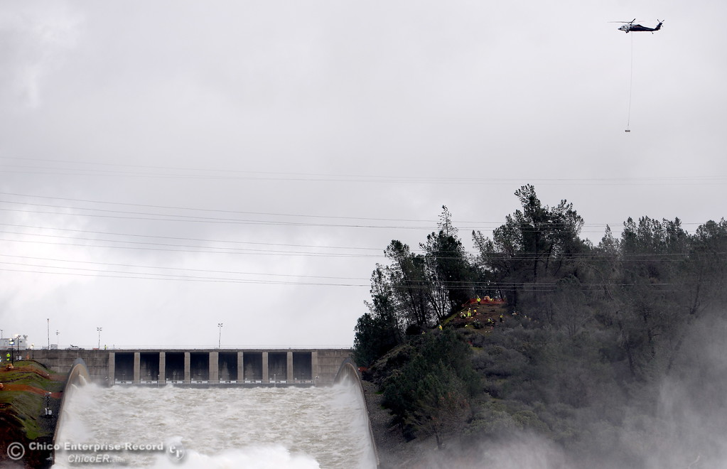 . Helicopters continue to work around the spillways as the Lake Oroville Dam Spillway emergency continues in Oroville, Calif. Thurs. Feb. 16, 2017. (Bill Husa -- Enterprise-Record)