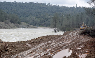 Equipment is seen working along the river below the Spillway Thursday as the Lake Oroville Dam Spillway emergency continues in Oroville, Calif. Thurs. Feb. 16, 2017. (Bill Husa -- Enterprise-Record)