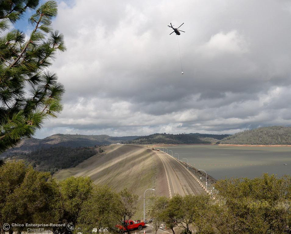 . A helicopter swoops in with another load as the Lake Oroville Dam Spillway emergency continues in Oroville, Calif. Thurs. Feb. 16, 2017. (Bill Husa -- Enterprise-Record)