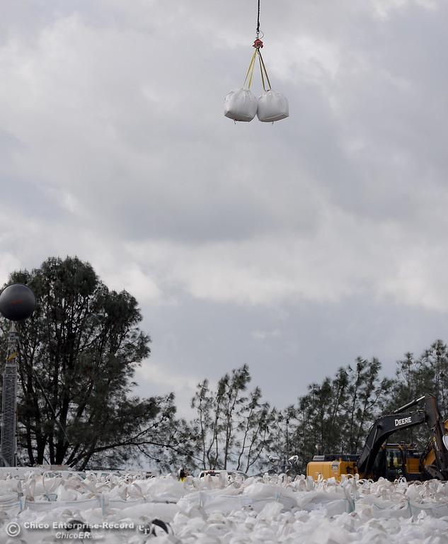 . A helicopter double bags it on this load as work continues the Lake Oroville Dam Spillway emergency continues in Oroville, Calif. Thurs. Feb. 16, 2017. (Bill Husa -- Enterprise-Record)
