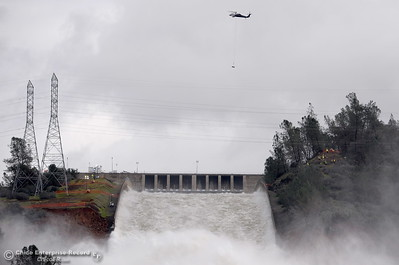 Helicopters continue to work around the spillways as the Lake Oroville Dam Spillway emergency continues in Oroville, Calif. Thurs. Feb. 16, 2017. (Bill Husa -- Enterprise-Record)