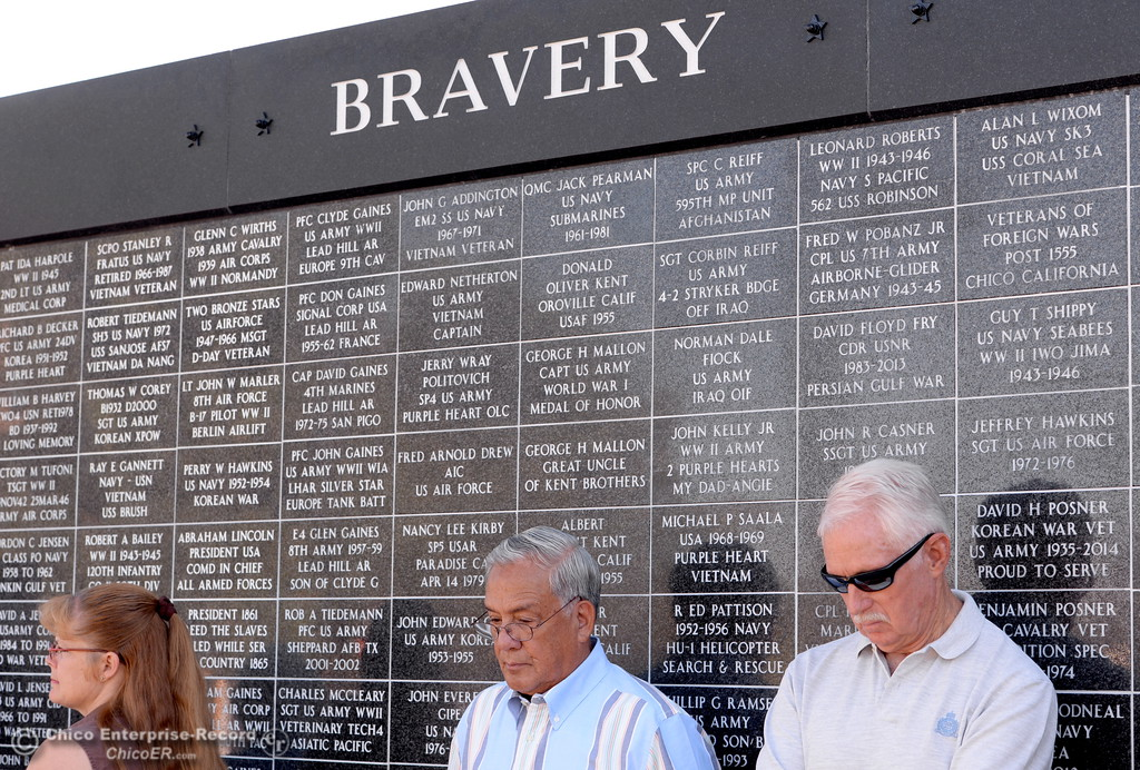 . People gather along the Wall of Honor during the Oroville Veterans Memorial Park opening ceremony Friday July 28, 2017. (Bill Husa -- Enterprise-Record)