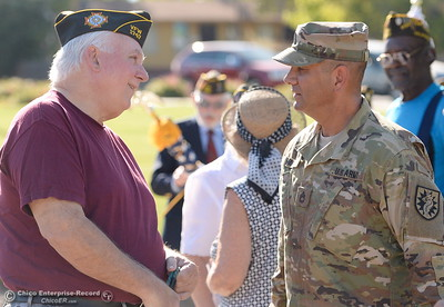 Veterans Joe Baker left and Daniel Madrid greet one another during the Oroville Veterans Memorial Park opening ceremony Friday July 28, 2017. (Bill Husa -- Enterprise-Record)