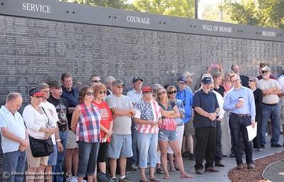 A crowd gathers in the shade of the Wall of Honor during the Oroville Veterans Memorial Park opening ceremony Friday July 28, 2017. (Bill Husa -- Enterprise-Record)